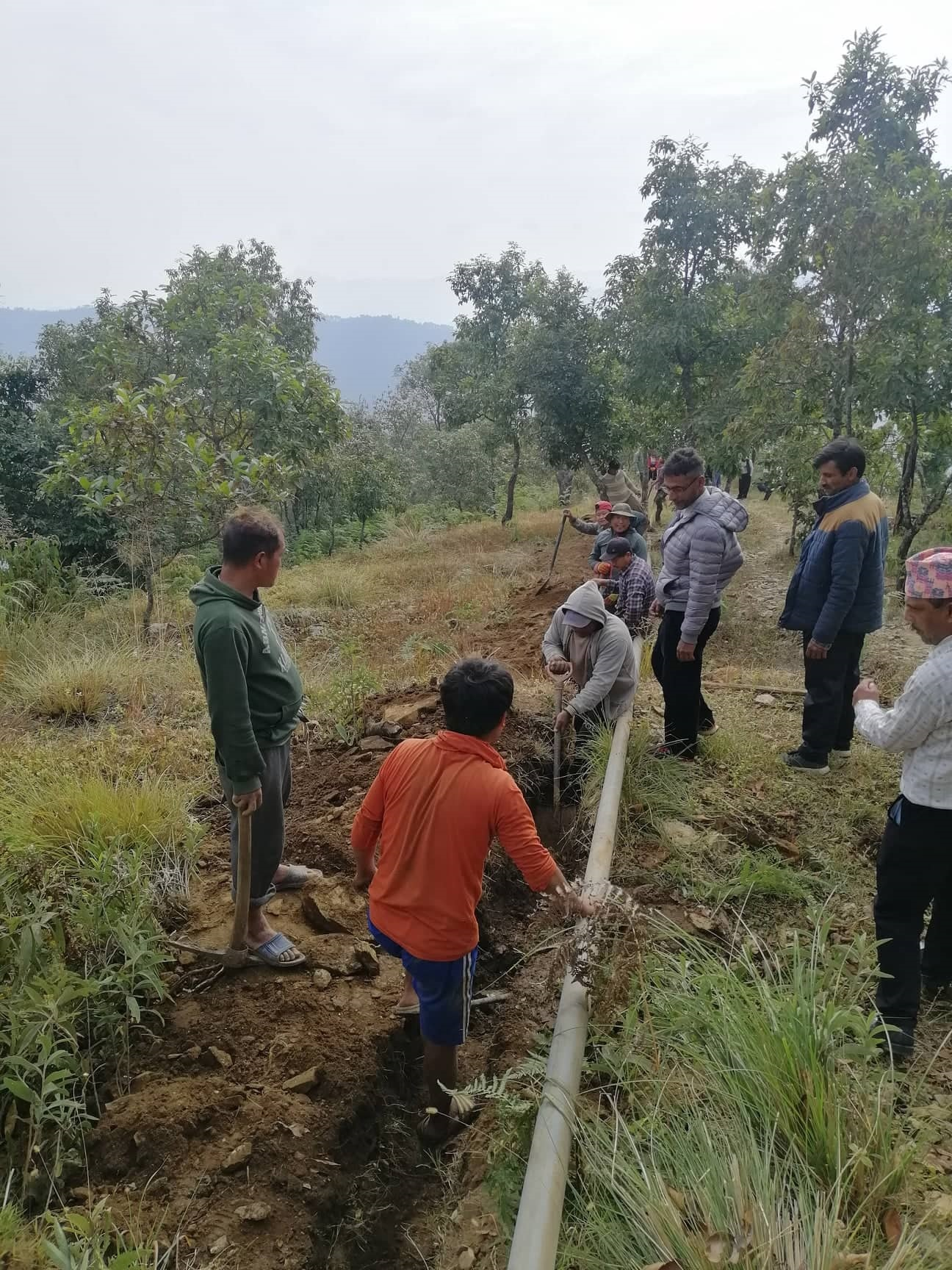 The villagers from Ramkot taking part in pipeline works as labor contribution